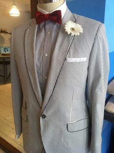 Grey and white searsucker with notch lapel and white pipping