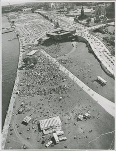 Throngs of people and cars surround the Milwaukee County War Memorial Center before additions were added . Aerial photo taken in pre-summerfest days and looks to the south. The C&NW depot can be seen in the upper right. Milwaukee County, Milwaukee Wisconsin, Historical Pictures, City Buildings, New Mexico, Great Places, History, Eero Saarinen, Heartland