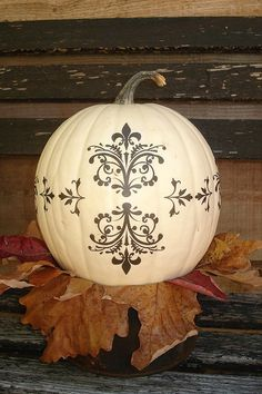 White pumpkin with black stencil = LOVE .....paint gold with fleur-de-lis stencil above and WHO DAT !