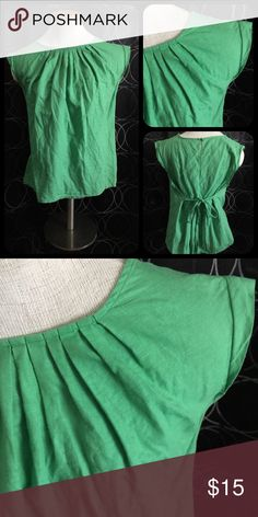 Banana Republic Green Top Worn a few times. In great condition. I'm terrible at ironing so please forgive the wrinkles. Banana Republic Tops Blouses
