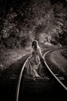 train tracks holds girl