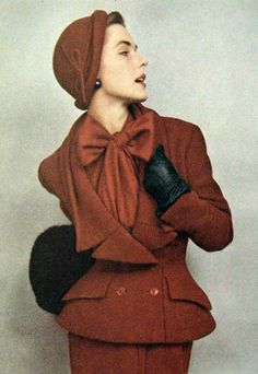 Late 40s new look brown bronze wool suit jacket skirt hat silk bow blouse shirt color photo print ad model magazine vintage fashion style The Couture Touch: Shades of Red, 1949