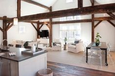 Barn Restored to a Home, this looks amazing with the original beams and modern contemporary interior.