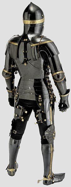 Armature jousting armor of Dr. Tobias Capwell, scholar and warrior. A unique armour in the English style, circa 1440 - made of hardened and tempered medium carbon steel with rich gilt ornamentation and gilt chainmail.