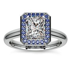 There's nothing like the charm of blue hues to bring out the sparkle in a diamond... Discover beauty in the Halo Sapphire Gemstone Engagement Ring in sleek Platinum, featuring an exquisite Radiant-cut diamond center surrounded by gorgeous blue sapphires! http://www.brilliance.com/engagement-rings/halo-sapphire-gemstone-ring-platinum