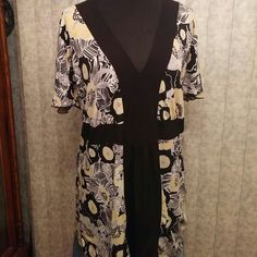 New listing! Floral tunic top Perfect for Spring! Cute floral tunic top with flutter sleeves & tie back.  Lightweight fabric - very flattering.  Excellent condition! Maurices Tops Tunics