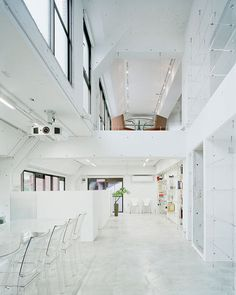 A small and irregularly shaped office in Japan has been transformed into a streamlined, linear, snow-white space by Tokyo-based practice Yoritaka Hayashi Architects.