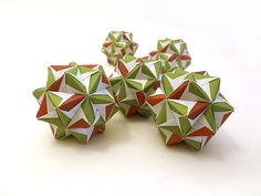 """https://flic.kr/p/NjC7Mk   Tree Deoor -- Sonobe Variation """"Cyclone""""   Tree decoration in traditional red/green.   The kusudama has been independently discovered by Dave Mitchell and Tadashi Mori..."""