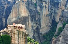 Building between mountains Photo by Tugo Cheng — National Geographic Your Shot