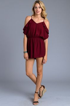 afe1f4ddd5a7 This burgundy ruffle romper is a must have for the warm season ahead.