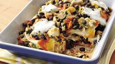 Luscious layers of tortillas, chicken, cheese and sauce create a mouthwatering Mexican main course.