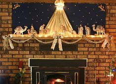 A mantle is the perfect place to display a crèche, Christmas village, or other heirloom decorations yet still keep them safely out of reach of pets and children. A simple swag beneath the mantle adds an appropriate border for the scene. Christmas Nativity Scene, Christmas Bells, Country Christmas, Christmas Holidays, Nativity Scenes, Xmas, Christmas Traditions, Christmas Themes, Christmas Decorations