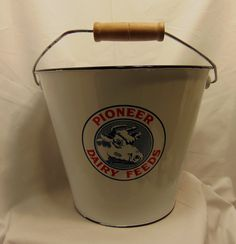 Pioneer Dairy Feeds White Enameled Bucket would look great in your farm house kitchen! Available online or in our shop. Bird's Nest Gifts and Antiques 117 N Main St Bryan, Texas, 77803