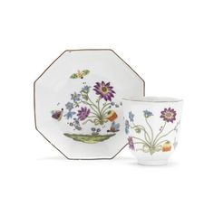 A Meissen octagonal beaker and saucer, circa 1740 Both painted with the Bienenmuster pattern of three insects around a spray of flowers tied with a yellow ribbon above a grassy vignette, brown-edged rims, crossed swords marks in underglaze-blue and blue, impressed numeral 23 to the saucer (very minor wear)