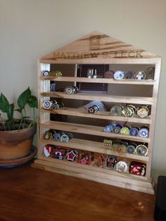 I can help you design your custom military challenge coin rack. Each shelf holds approximately 10 coins. Standard racks come with 6, 8 or 10 rows