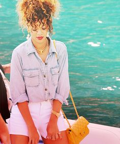 I love her hair...just her whole look! Can't forget the yellow Chanel!