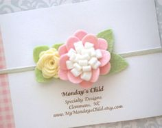 Pick your favorite! Sweet spring wildflowers in your choice of linen, peach and pink! These little posies measure 2.50 inches wide and are attached to a nylon one size fits most (newborn to small child) band. Perfect for spring and available in other colors - just send me a message! *Shipping - The current processing time before shipping is 1 to 2 weeks!  Thank you