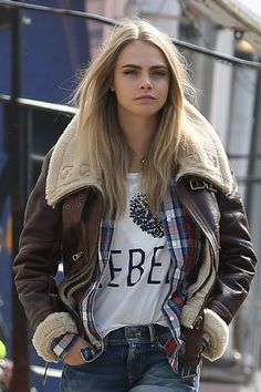 Brit girl fashion: Make like Cara and chuck on a chunky collared jacket.