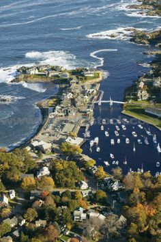 """Perkins Cove, Ogunquit, Maine. """"Loved it there!!!! I want to go back!"""" A visit to the lively Perkin's Cove is definitely in order. This miniature working lobster and fishing village is chock full of wonderful little shops and restaurants. There is a walking drawbridge, a beautiful walkway along the ocean (known as The Marginal Way) and numerous boating excursions that sail from Ogunquit harbor's docks."""
