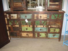 multi-colored painted dresser or buffet table