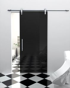 modern, black barn type door/black and white flooring
