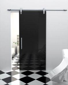 modern, black barn type door/black and white flooring