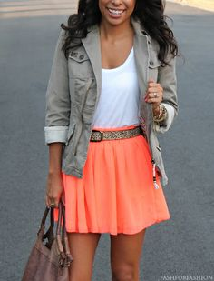 masculine neutral jacket with a bright feminine skirt.
