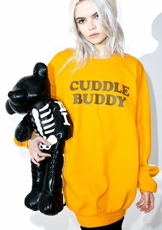 Petals and Peacocks Cuddle Buddy Sweatshirt we just wanna squeeze yer cute lil body, bb! Get cozy in this ultra soft sweatshirt, featurin' a plush golden yellow fleece construction, suuuper slouchy oversized fit, rounded neckline, banded trim, and big lettering across the chest reading 'Cuddle Buddy.'
