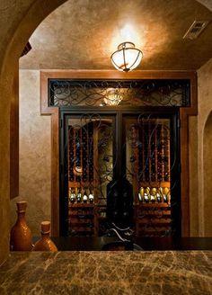 Traditional Wine Cellar with Built-in bookshelf, Transom window, French doors, flush light