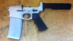 3-D printed AR-15 lower receiver + magazine. Receiver can take at least 600 rounds.