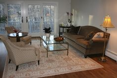 Living Room by Sam Avola Designs  love the rug, chairs and couch. (not crazy about the tables and lighting)