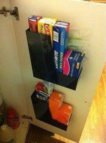 Save space by attaching magazine holders inside kitchen cupboard doors, use for long narrow boxes such as saran wrap, foil, waxed paper, etc.