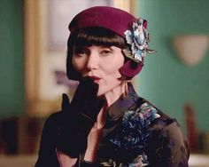 Her earrings always match her hat or headpiece. | Community Post: 21 Reasons Why Miss Phryne Fisher Is A Fashion Icon