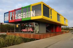 renault shipping container pavilion on l'ile seguin, paris. Designed by Mahn Architecture  Nancy to provide visitors with information about the automotive manufacturers long and rich history.