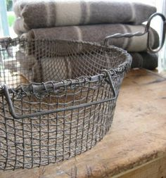 Wool, wood and wire all design elements of farmhouse style White Cottage, French Cottage, Cozy Cottage, French Country, Farmhouse Style, Farmhouse Decor, Farmhouse Baskets, Metal Baskets, Vintage Baskets