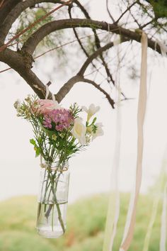 Hanging jar of mixed flowers. Photography Wild Rose Photography