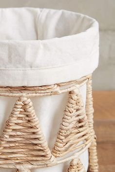 Anthropologie EU Woven-Wedge Baskets. Beautifully handmade linen baskets add a rustic, exotic touch to the abode.