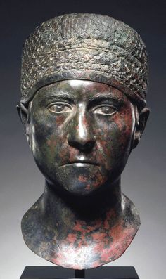 Roman, Trajanic Portrait head of a woman, A.D. 98–117 Bronze with silver inlay