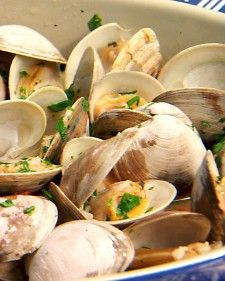 And this is dinner!   In this no-fuss recipe from chef Chris Schlesinger, toss littleneck clams directly onto the grill, cook until they open, and serve with a wine-butter sauce.Also try: Barbecued Oysters with Bacon and Garlic Butter, Southeast Asian-Style Grilled Shrimp with Aromatic Herbs