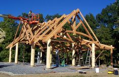Raising of a pavilion with peeled posts and intersecting roof lines.