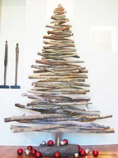 Here is a roundup of 21 unique and creative Christmas tree design ideas from around the globe to inspire you in designing your own tree. Recycled Christmas Tree, Stick Christmas Tree, Creative Christmas Trees, Alternative Christmas Tree, Christmas Tree Design, Wooden Christmas Trees, Noel Christmas, Modern Christmas, Christmas Tree Decorations