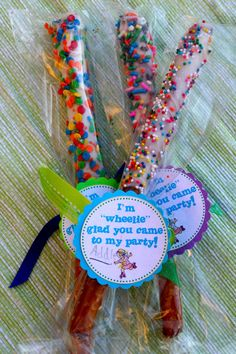 """I'm 'wheelie' glad you came to my party!"" chocolate covered pretzels dipped in sprinkles for party @flibbertigibberish"