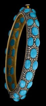 14 karat yellow and blackened gold diamond and turquoise bangle   Accented by bezel set, oval and pear shaped turquoise over petite round cut diamonds.