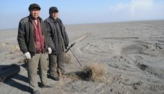 Villagers Su Bairen, 69, and Yan Man Jia Hong, 74, stand on the edge of the six-mile-wide toxic lake in Baotou, China that has devastated th...