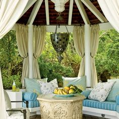 Outdoor Affair - A draperied gazebo creates a tropical hideaway and a picturesque setting to witness a storm, escape the heat, or enjoy an                                            alfresco meal.