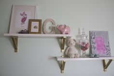 IKEA Wall Shelves with Gold Spray Painted Brackets - we seriously love this DIY look for the nursery!