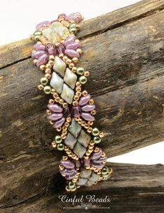 Another great design by Deb Roberti-the Solitaire bracelet. Its constructed with superduos and diamonduos interspersed with fire polish beads and Toho seed beads. The colors consist of pale olive and amethyst surrounded by rose gold seed beads. The clasp is a superduo beaded loop