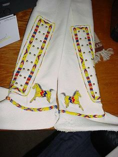 Ladies beaded southern style leggings finished in 13/0 cut glass beads with horse design. SOLD