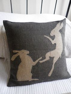 charcoal hand printed tumbling hares cushion cover by helkatdesign, $78.00