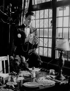 Waiter knitting garments during drive to provide goods to servicemen during the war. (Life archives)